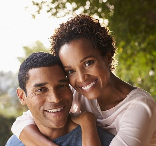 young-black-couple-piggyback-in-garden-looking-at-SQUARE.jpg